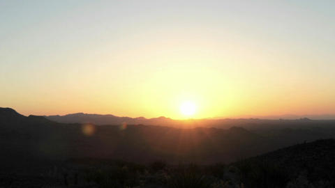 The sun appears over the horizon at golden hour Stock Video Footage