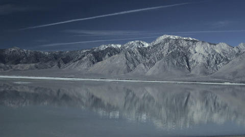 A lake reflects the mountains Stock Video Footage