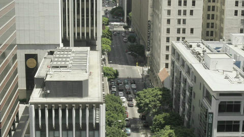 Traffic passes down a busy metropolitan street Stock Video Footage