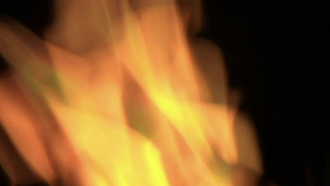 Bright orange flames flicker in a blazing fire Stock Video Footage