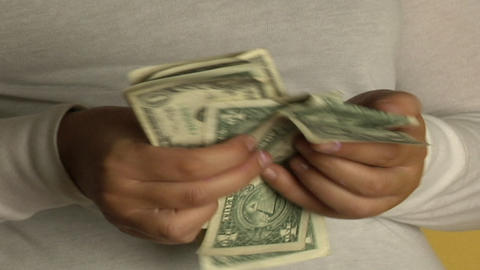 A woman counts dollar bills Stock Video Footage