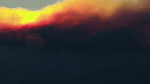 Smoke passes over the sun Footage