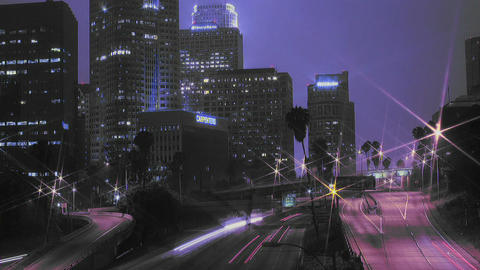 Heavy traffic drives on a busy freeway in a city at night Stock Video Footage