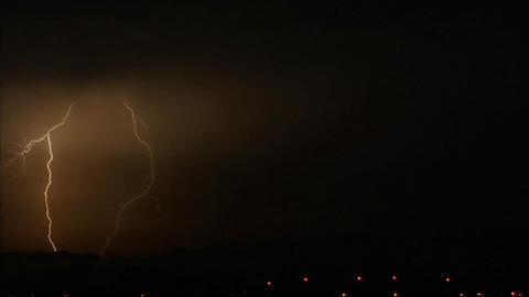 Lightening strikes illuminate a dark sky Stock Video Footage