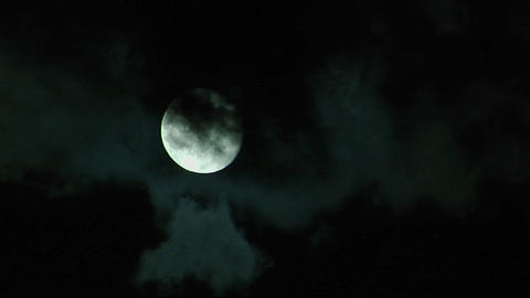 Clouds pass before a bright full moon Stock Video Footage