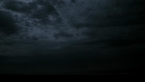 Lightning flashes under fast-moving storm clouds Footage