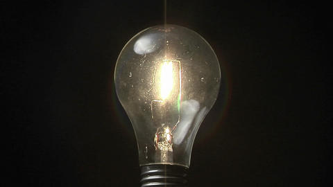 A light bulb lights up Stock Video Footage