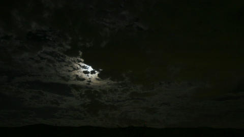 Dark clouds move across the moon in this haunting scene Stock Video Footage