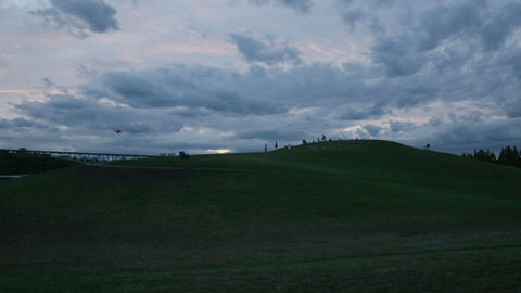 Clouds and people move across the sky behind a landfill Footage