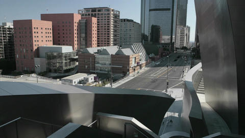 Traffic drives past downtown office buildings Stock Video Footage