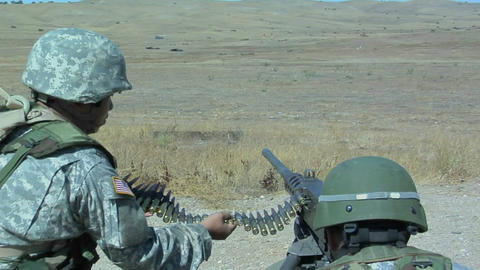 A soldier fires an automatic weapon Stock Video Footage