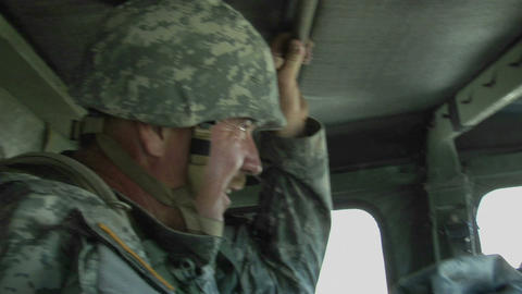 A soldier rides in an armored vehicle Stock Video Footage