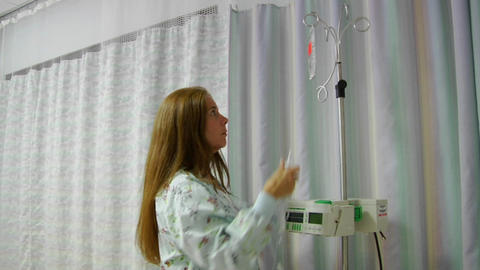 A nurse prepares IV equipment Footage