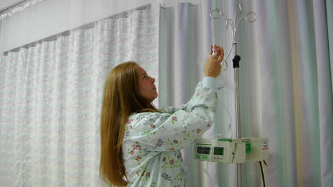 A nurse prepares IV equipment Stock Video Footage