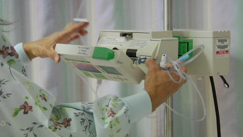 A nurse prepares medical equipment Footage