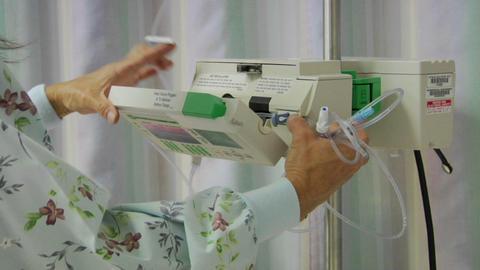 A nurse prepares medical equipment Footage