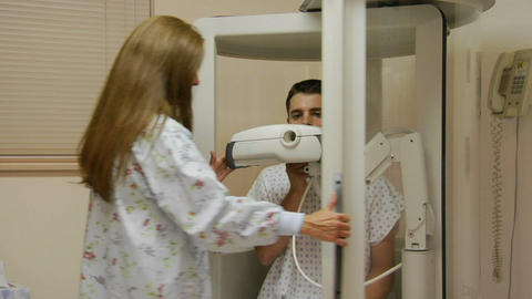 A nurse encloses a patient in a medical machine Stock Video Footage
