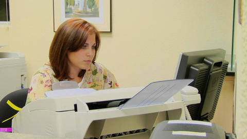 A woman types at a computer Footage
