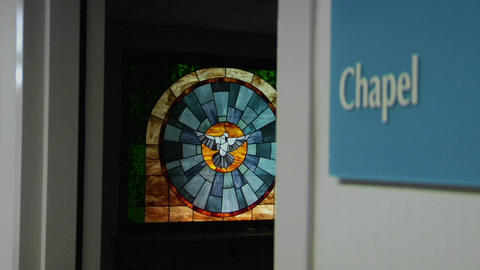 A stained glass window beautifies a hospital chapel Stock Video Footage
