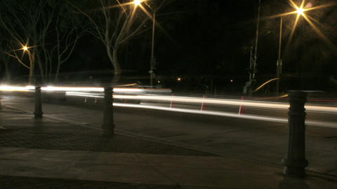 Vehicles speed along a road at night Stock Video Footage