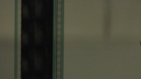 A strip of film runs vertically Footage