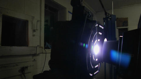 Light shines through a film projector Stock Video Footage