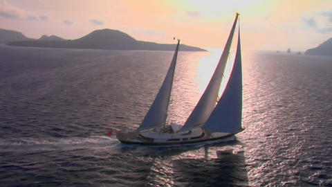 An aerial of a magnificent sailing ship silhouetted... Stock Video Footage