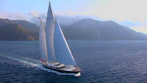An aerial over a magnificent sailing boat on the open ocean Stock Video Footage