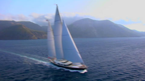 An aerial over a magnificent sailing boat on the open ocean Footage