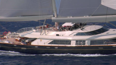 A medium shot alongside a sailboat at sea Stock Video Footage