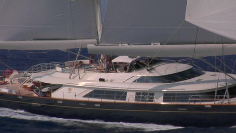 A medium shot alongside a sailboat at sea Stock Video Footage