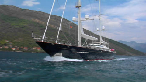 A traveling shot across the bow of a large sailing vessel Footage