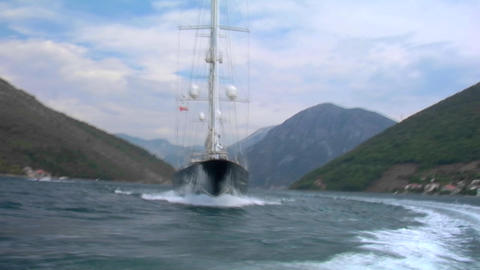 A traveling shot across the bow of a large sailing vessel Stock Video Footage
