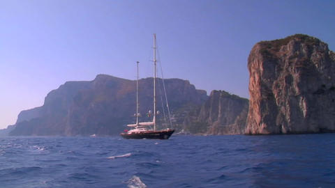 A medium shot of a sailing vessel moving along the... Stock Video Footage