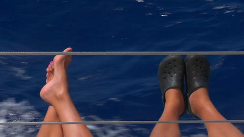 feet stick out against the wake of a boat Stock Video Footage