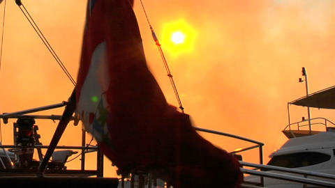 The flag of the Cayman Islands flies behind the sun Stock Video Footage