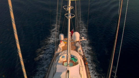 A view straight down from the crows nest of a sailing ship to the fore deck below Footage