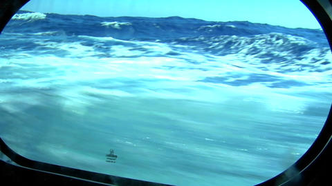 A view through the porthole of a sailing vessel under the sea Footage