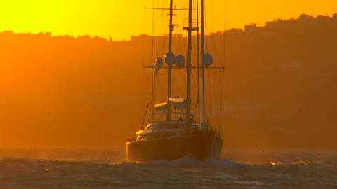 A sailboat against the setting sun Stock Video Footage