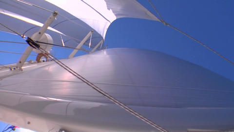 A shot looking straight up at the sail of a sailboat Footage