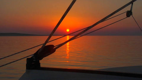 A beautiful sunset seen through the rigging of a sailboat Stock Video Footage