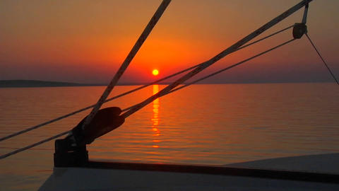 A beautiful sunset seen through the rigging of a sailboat Footage