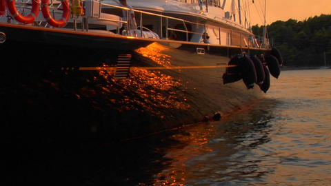 Sunset reflection on the hull of a sailboat docked in the... Stock Video Footage