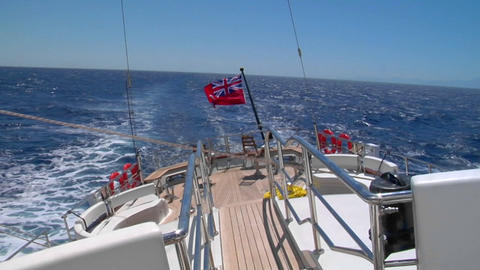 A view of the aft deck of a sailboat healing starboard, a... Stock Video Footage