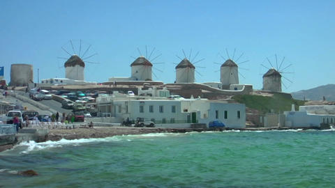 View of Mykonos windmills, Greece shore as waves crash Stock Video Footage