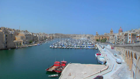 Wide view of Malta's old city scape and ships in the harbor Stock Video Footage