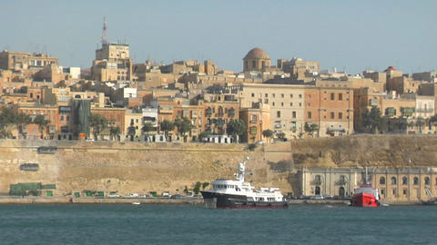 View of Malta's old city scape with a ship coming into... Stock Video Footage