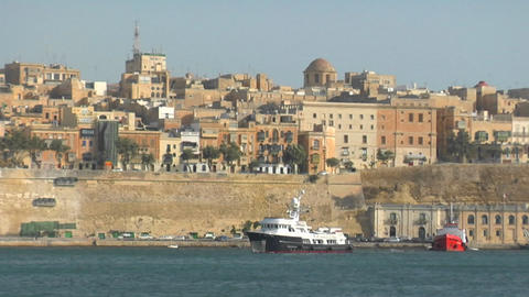 View of Malta's old city scape with a ship coming into the harbor Footage