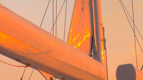 View of sails on sailboat as sun reflects on them Stock Video Footage