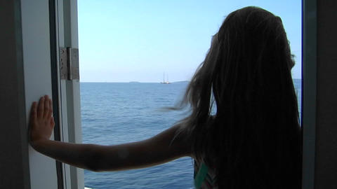 A girl stands in the doorway of a ship looking out on the... Stock Video Footage